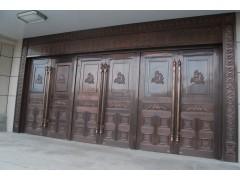铜包饰地弹门